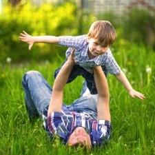 bigstock-Father-and-son-playing-lying-o-46173241