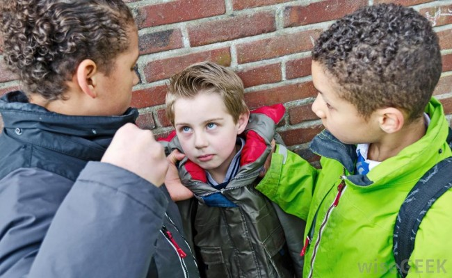 boy-child-being-bullied-by-two-other-boys