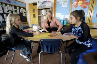 Kyle Schwartz, 3rd grade teacher, works with students at Doull Elementary School in Denver
