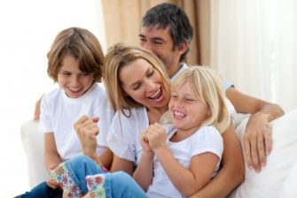bigstock_happy_family_relaxing_on_the_s_6558303