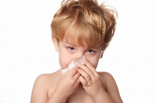 bigstockphoto_Sick_Child_Wiping_His