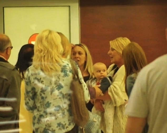 """Pic shows: British social worker who brought the baby to Slovakia, holding Benjamin at Bratislava airport on May 19. British social workers have flown the baby of a Slovak mum who had settled in Britain but no longer wanted the child back to Slovakia. The six-month-old boy called Benjamin was returned to Slovakia by two social workers from Liverpool. The tiny tot was handed over to Slovak social workers at Bratislava Airport. The unmarried mother who has not been identified told British Social Services that she did not want to take care of her baby anymore. The father of the baby is unknown but is believed to be Slovakian. As the baby had a Slovak birth certificate, British Social Service contacted the Slovak Center for International Legal Protection of Children and Youth. This is the government body which providing legal protection for children in foreign countries. Arrangements were then made to take the baby to Slovakia. A British social worker who was flying with Benjamin from Liverpool to Bratislava said the baby was a little bit nervous during the 2 hour and 40 minute long flight. She said: """"His teeth are growing so he was crying a little bit more, but he is a cute baby and is at the moment all right."""" A Slovak social worker said: """"I hope that his life here will be good. He will grow up in his homeland and he will learn his own culture. I think he will be happy."""" Andrea Cisarova, chief of the Centre for International Legal Protection of Children and Youth said: """"The British informed us that the baby is legally our responsibility. We put in to take it back immediately. The baby is small but they decided to give it back to its homeland."""" Little Benjamin was taken to a children's home and then given to a surrogate family who will look after him until he is adopted. (ends)"""