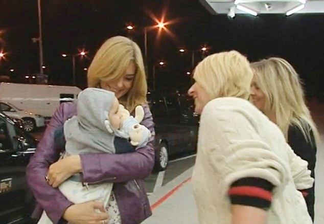 """Pic shows: Two British social workers saying good-bye to the Slovak baby in front of Bratislava airport. British social workers have flown the baby of a Slovak mum who had settled in Britain but no longer wanted the child back to Slovakia. The six-month-old boy called Benjamin was returned to Slovakia by two social workers from Liverpool. The tiny tot was handed over to Slovak social workers at Bratislava Airport. The unmarried mother who has not been identified told British Social Services that she did not want to take care of her baby anymore. The father of the baby is unknown but is believed to be Slovakian. As the baby had a Slovak birth certificate, British Social Service contacted the Slovak Center for International Legal Protection of Children and Youth. This is the government body which providing legal protection for children in foreign countries. Arrangements were then made to take the baby to Slovakia. A British social worker who was flying with Benjamin from Liverpool to Bratislava said the baby was a little bit nervous during the 2 hour and 40 minute long flight. She said: """"His teeth are growing so he was crying a little bit more, but he is a cute baby and is at the moment all right."""" A Slovak social worker said: """"I hope that his life here will be good. He will grow up in his homeland and he will learn his own culture. I think he will be happy."""" Andrea Cisarova, chief of the Centre for International Legal Protection of Children and Youth said: """"The British informed us that the baby is legally our responsibility. We put in to take it back immediately. The baby is small but they decided to give it back to its homeland."""" Little Benjamin was taken to a children's home and then given to a surrogate family who will look after him until he is adopted. (ends)"""