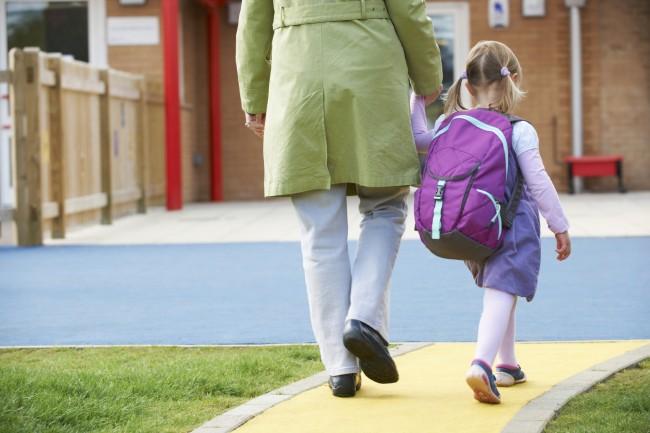 Mom-walking-daughter-to-school