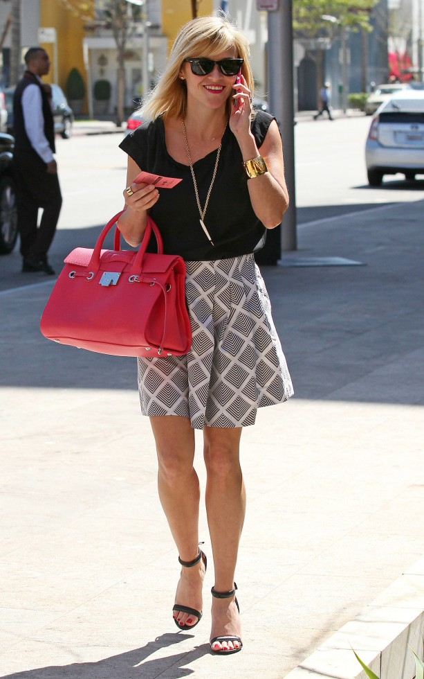 Reese-Witherspoon-Graphic-Skirt-Red-Jimmy-Choo-Bag