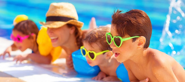 bigstock-Happy-family-in-the-pool-havi-50515637