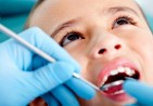 bigstock-Kid-at-the-dentist-getting-his-28843772