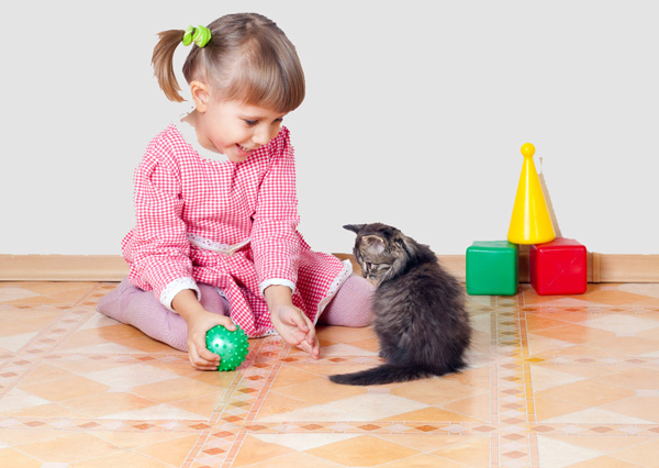girl playing with kitten_0