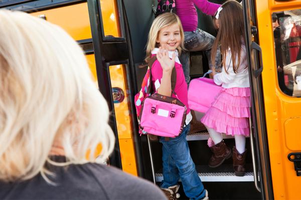 little-girl-boarding-schoolbus