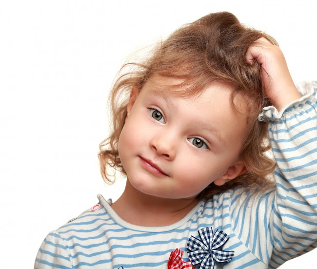 photodune-7593555-cute-small-kid-girl-thinking-holding-the-head-isolated-closeup-potrait-on-white-m