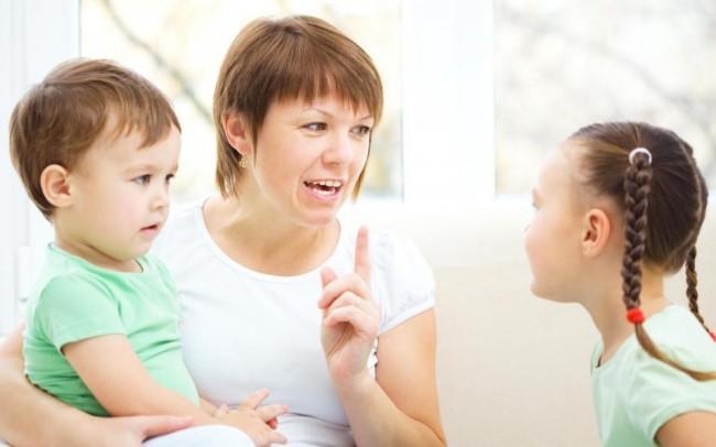 woman-holding-boy-talking-to-girl