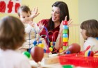 three-little-girls-and-female-teacher-in-kindergarten