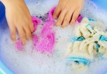 washing-garments-in-soapy-water-in-blue-tub