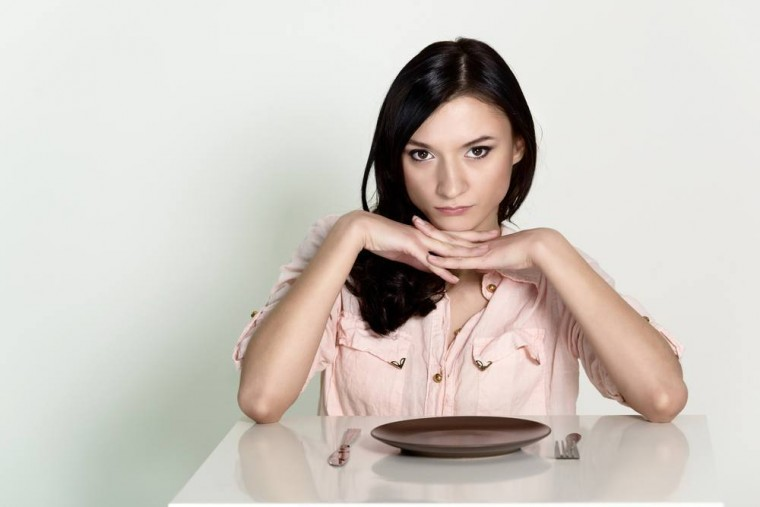 woman-sitting-with-an-empty-plate-facebook