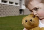 Boy with Black Eye Hugging Teddy Bear --- Image by © Guntmar Fritz/zefa/Corbis
