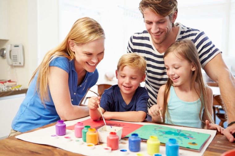Parents-Painting-Picture-With-Children-At-Home-Dollarphotoclub_70864529
