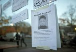 In this Oct. 26, 2015 file  picture , a  poster  to find  4-year-old Mohamed Januzi  is on display  outside the  state office for health and social affairs  in Berlin,  Berlin police say Thursday Oct. 29, 2015  they have arrested a suspect in the disappearance earlier this month of 4-year-old Bosnian boy  Mohamed Januzi leaving the central registration center for migrants in Berlin,  and have found the body of a child in the suspect's car.   (Michael Kappeler/dpa via AP)