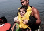 A-refugee-carries-a-child