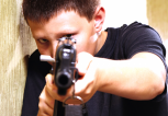 Teenage-white-boy-points-rifle-at-school-gun-school-shooting-Shutterstock-800x430
