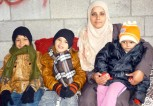 Children-Wearing-Their-New-Winter-Clothes-Gaza-January-2014