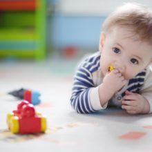 baby-boy-playing-with-bricks-1
