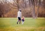 mom-toddler-boy-walking-park-2016