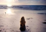 Girl-sitting-alone-in-sea-side-beach-watching-sunset-HD-image