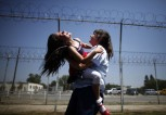 Cori Walters, 32, (R) hugs her daughter Hannah Walters, 6, at California Institute for Women state prison in Chino, California May 5, 2012. An annual Mother's Day event, Get On The Bus, brings children in California to visit their mothers in prison. Sixty percent of parents in state prison report being held over 100 miles from their children. REUTERS/Lucy Nicholson (UNITED STATES)