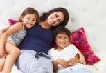 mom-in-bed-with-kids