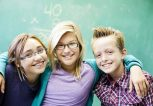 lifestyle_kids-at-school-near-chalkboard_caucasian