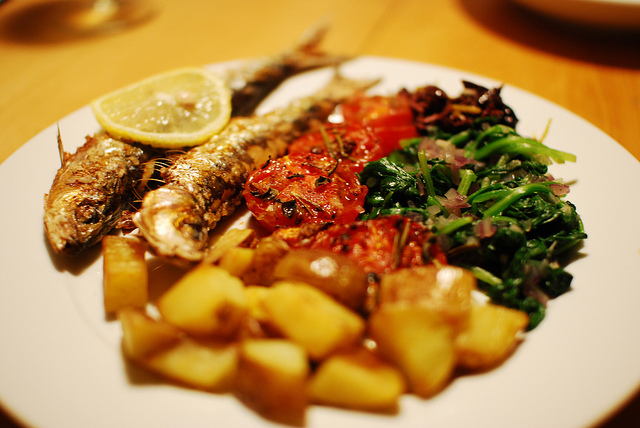 grilled sardines with wild sauteed spinach, grilled tomatoes, ol