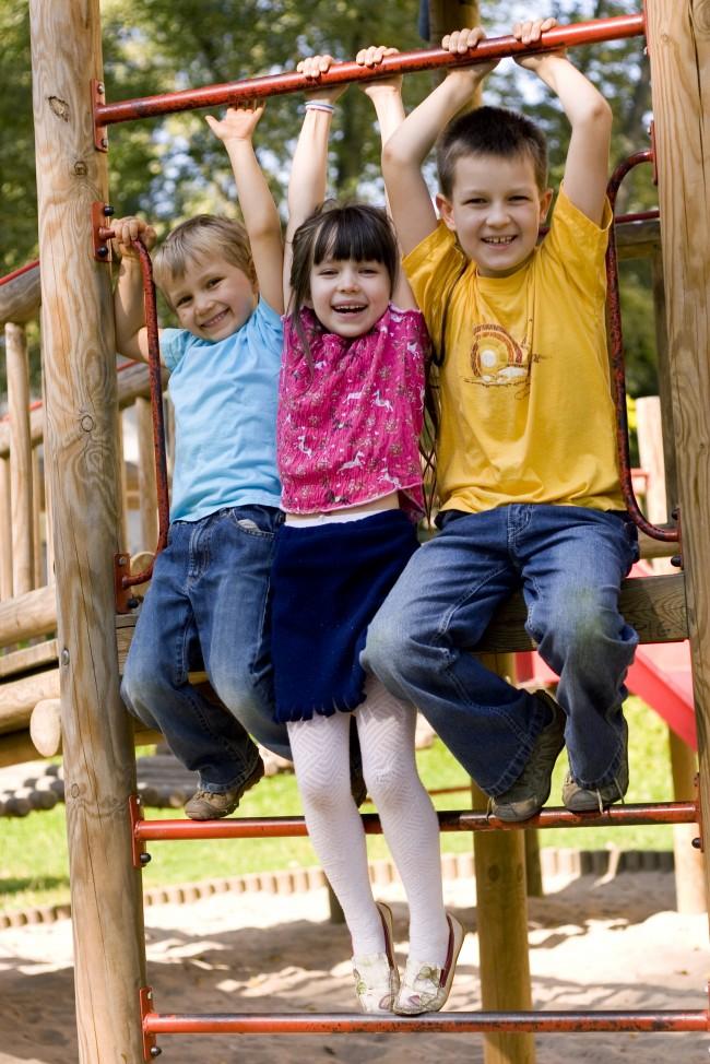 is_23172083-children-grasping-overhead-bars