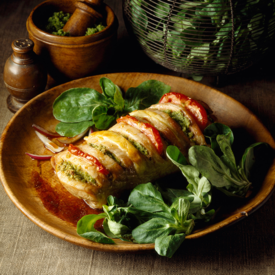 roast veal stuffed with herbs, tomato and cheese