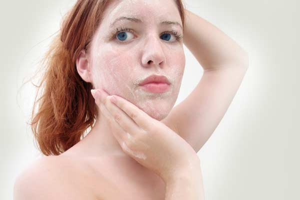 woman-with-facial-scrub