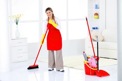 Charwoman sweeping a room.