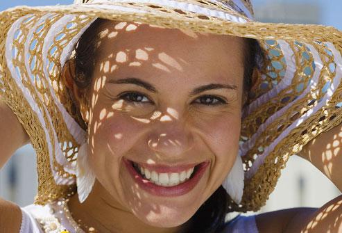 photolibrary_rf_photo_of_woman_wearing_sun_hat
