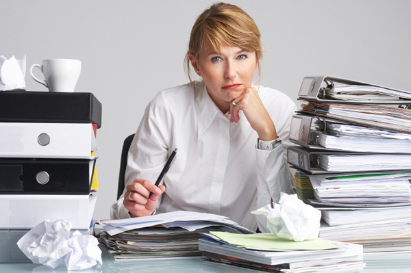 stressed-woman-at-work-paperwork