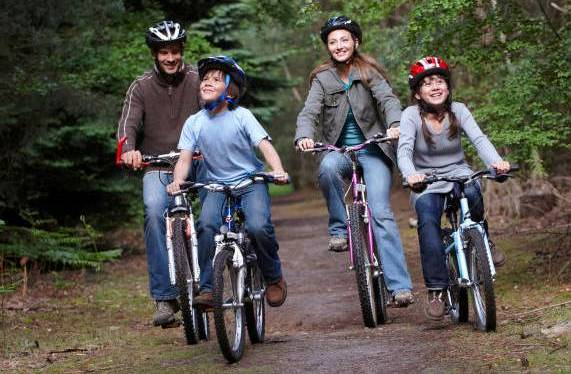 Family biking through Forest