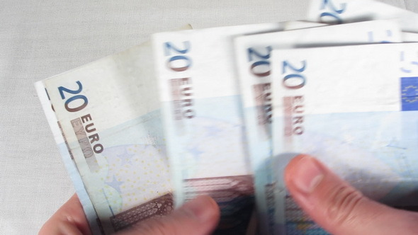 Holding-And-Counting-20-Euros-Banknotes