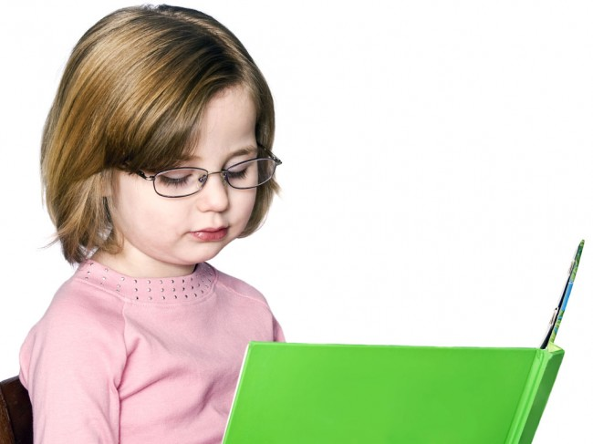 child-reading-book-stock-photo