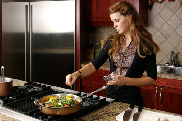 woman-cooking-with-skillet
