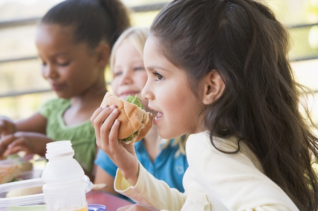 bigstock_Students_outdoors_eating_lunch_19860467