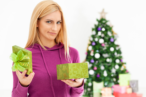 disappointed-woman-holding-present