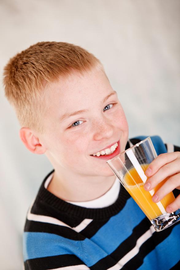 Boy-drinking-orange-juice-MG-1951