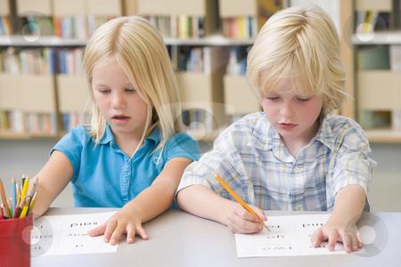 cutcaster-photo-100138412-Kindergarten-children-learning-to-write