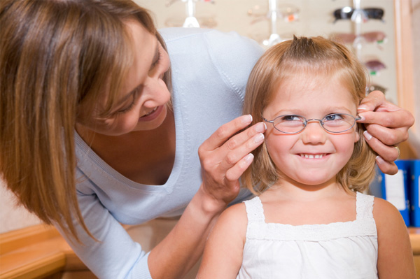 little-girl-being-fitted-for-glasses