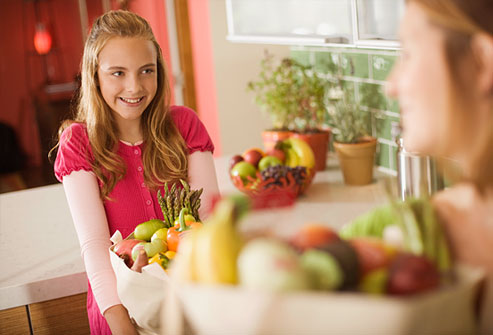 getty_rm_photo_of_teen_holding_bag_of_healthy_groceries