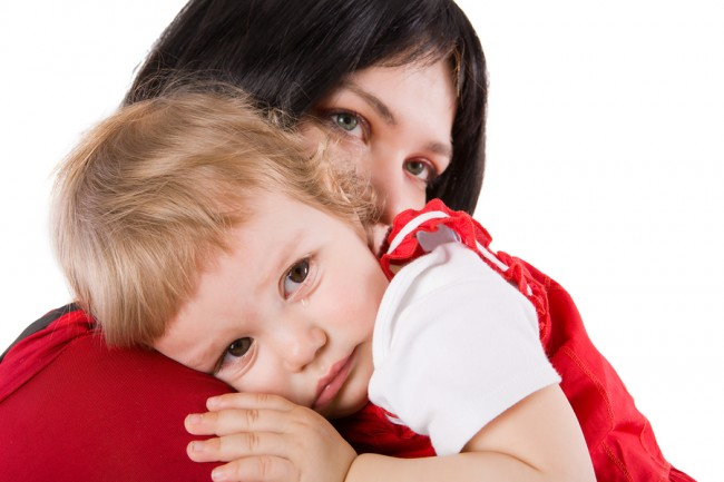 bigstockphoto_Mother_Holding_Crying_Baby_5342577