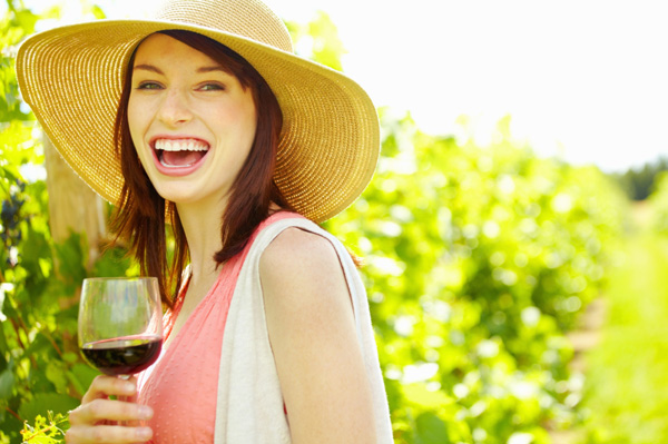 happy-woman-drinking-wine-summer