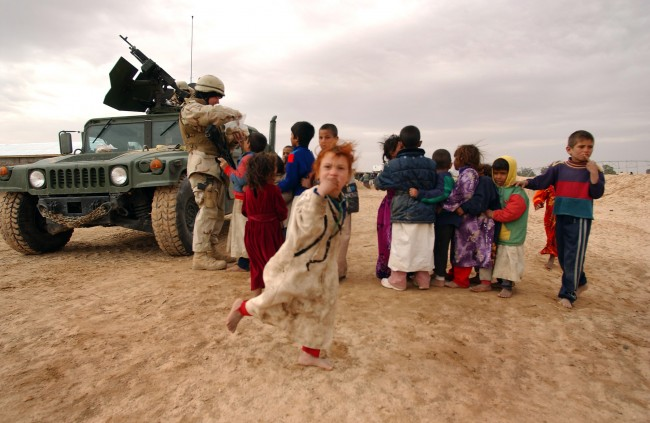 US_Navy_050124-N-1810F-592_Seabees_hand_out_cookies_to_local_Iraqi_children